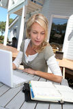 Woman teleworking on laptop Royalty Free Stock Images