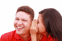 Woman telling a man a secret Royalty Free Stock Image