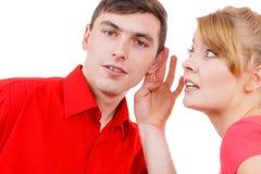 Woman telling man some secrets, couple talking Stock Photo