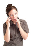 Woman telling secret by the cell phone Stock Photography