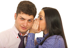 Woman telling secret to man Stock Images