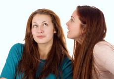 Woman telling secrets Royalty Free Stock Images
