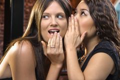 Woman telling secrets Stock Photo