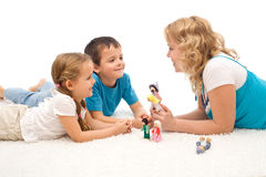 Woman telling a story to her kids on the floor Stock Image
