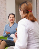 Woman tells the doctor the symptoms of malaise Royalty Free Stock Photography