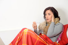Woman  with a temperature Royalty Free Stock Photos