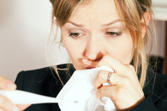 Woman with temperature and flu Stock Images