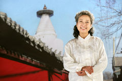 Woman beside the temple Stock Photo