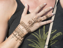 Woman with a temporary Henna design Stock Photo