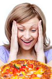Woman tempted by a pizza Stock Photography