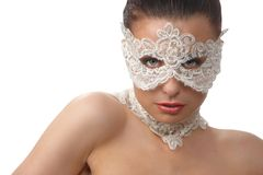 Woman with tender face in lace mask over her eyes Royalty Free Stock Photos