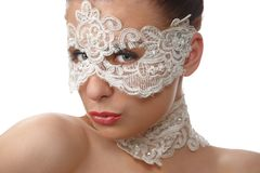 Woman with tender face in lace mask over her eyes Royalty Free Stock Photography