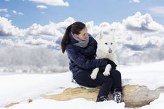 Woman tenderly hugging dog Royalty Free Stock Photo