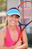 Woman Tennis. Beautiful young athletic woman playing tennis on a summer afternoon Royalty Free Stock Photos