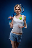 Woman with a tennis ball Royalty Free Stock Photography