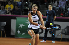 Woman tennis player in action Stock Images