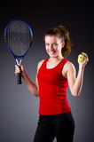 Woman tennis player against dark background Stock Images