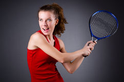 Woman tennis player against dark background Royalty Free Stock Photo