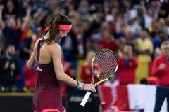 Woman tennis player celebrating the victory. CLUJ NAPOCA, ROMANIA - FEBRUARY 10, 2018: Romanian tennis player Sorana Cirstea celebrating victory against Carol Royalty Free Stock Photography
