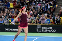 Woman tennis player celebrating the victory. CLUJ NAPOCA, ROMANIA - FEBRUARY 10, 2018: Romanian tennis player Sorana Cirstea celebrating victory against Carol Stock Image