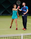 Woman tennis player and her coach Royalty Free Stock Photos