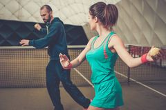 Woman tennis player and her coach Royalty Free Stock Image