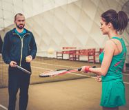 Woman tennis player and her coach Stock Image