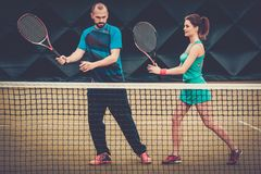 Woman tennis player and her coach Royalty Free Stock Images