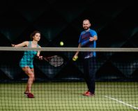 Woman tennis player and her coach Royalty Free Stock Photography