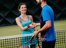 Woman tennis player with her coach Royalty Free Stock Image