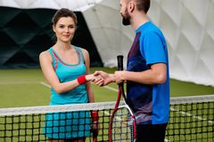 Woman tennis player with her coach Royalty Free Stock Photo