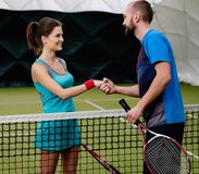 Woman tennis player and her coach Royalty Free Stock Photo