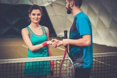 Woman tennis player and her coach Stock Photos