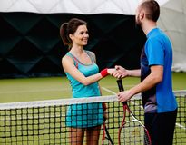 Woman tennis player and her coach Stock Photography