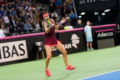Woman tennis player hitting the ball. CLUJ NAPOCA, ROMANIA - FEBRUARY 10, 2018: Romanian tennis player Sorana Cirstea playing tennis against Carol Zhao during a Royalty Free Stock Images