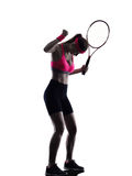 Woman tennis player sadness silhouette. One woman tennis player  in studio silhouette isolated on white background Royalty Free Stock Photography