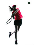 Woman tennis player sadness silhouette. One woman tennis player sadness in studio silhouette isolated on white background Stock Photo