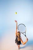 Woman with tennis racket Stock Image