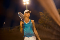Woman with tennis racket outdoors Royalty Free Stock Image