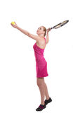 Woman with tennis racket serving the ball Stock Image