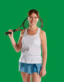 Woman with a tennis racket. Successful sportswoman with racket. in a green screen studio.Young woman with copy space on green screen chroma key Stock Photo