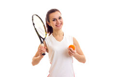 Woman with tennis racquet and ball Stock Image