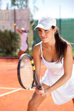 Woman with tennis racquet. Woman holding a tennis racquet at the tennis court Royalty Free Stock Photos