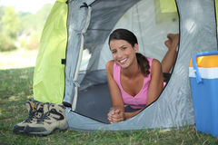 Woman in a tent Royalty Free Stock Image