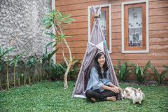 A woman in a tent on. Asian woman sitting in a tent in the backyard Stock Image