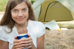Woman tent camping. Young woman on camping with tent in background royalty free stock image