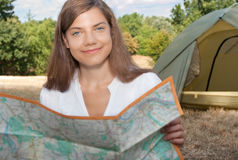 Woman tent camping map Royalty Free Stock Images