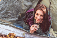 Woman in tent holding metallic cup Royalty Free Stock Photo