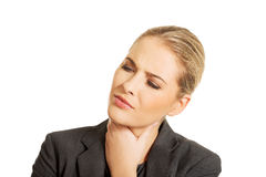 Woman with terrible throat pain. Businesswoman with terrible throat pain Royalty Free Stock Images
