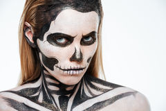 Woman with terrifying skeleton makeup. Over white background Stock Images